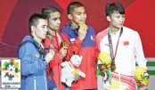 Amit stuns Olympic champ, Uzbeks lords of Asian ring