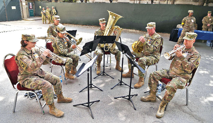 US military personnel play during a change of command ceremony