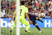 Magical Messi, Suarez hit doubles in 8-2 rout of Huesca