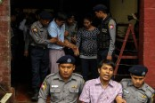 Myanmar court sentences Reuters reporters to 7 years in jail