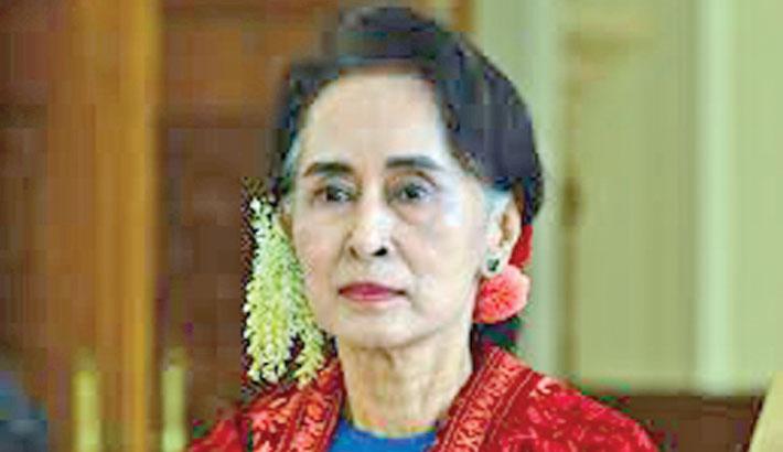 Myanmar defends Suu Kyi's silence over jailed reporters