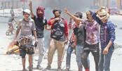 Yemeni protesters block a road