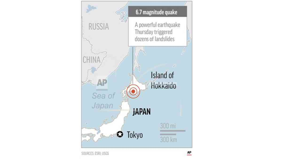 Japan quake toll up to 16 as rescuers dig through landslides
