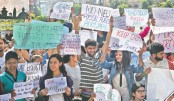 Nepali school students hold placards at a protest rally