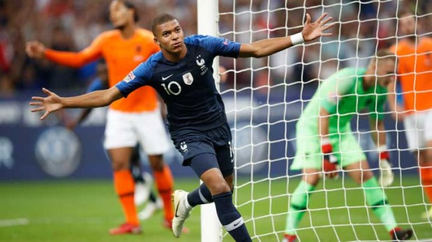Mbappe, Giroud score as France makes successful return home