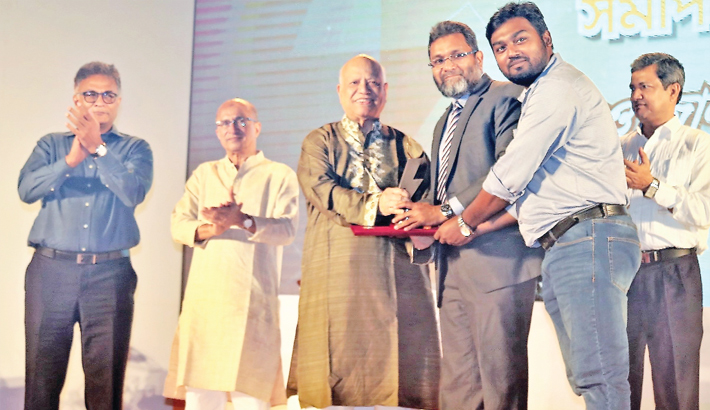 Finance minister AMA Muhith hands over the first place award