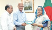Prime Minister Sheikh Hasina receives a donation cheque