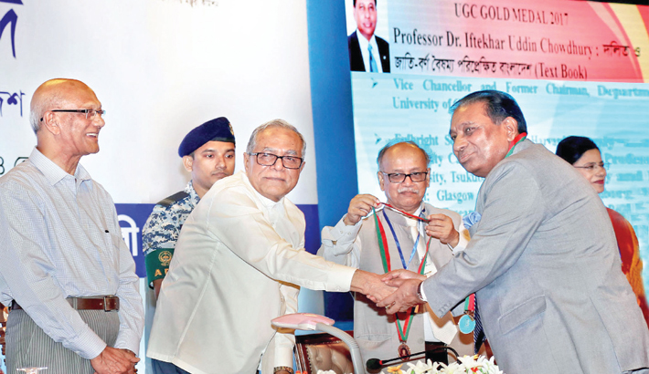 President Abdul Hamid hands over the UGC Gold Medal