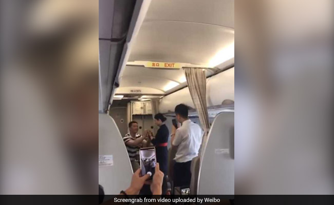 Chinese flight attendant fired after accepting mid-air marriage proposal (Video)
