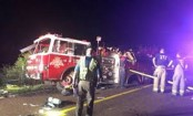 21 killed in a bus crash on a road in central Iran