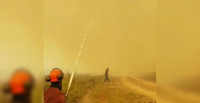 Firefighters try to save hose in tug-of-war with firenado in Canada (Video)