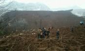 New landslide kills 21, buries houses in Philippines