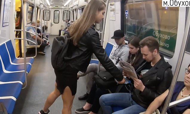 Russian woman splashes bleach on to groins of men sitting with legs spread wide
