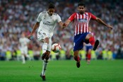 Madrid and Atletico draw in derby, Barcelona stays ahead