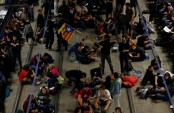 Pro-independence protesters in Catalonia block roads, railway line: TV