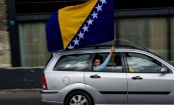 Bosnians vote after 'divisive' campaign
