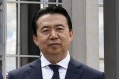 Interpol chief resigns after detention in China