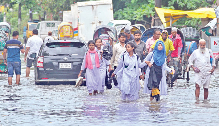 Rain, tidal water inundate port city again