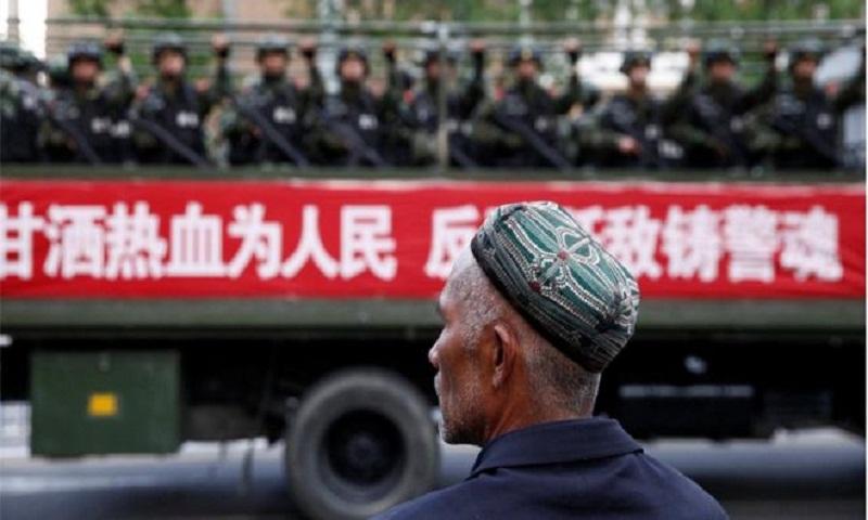 China Uighurs: Xinjiang legalises 'reeducation' camps