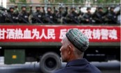 China Uighurs: Xinjiang legalises 'reeducation' camps