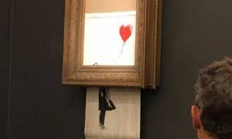 Woman to keep shredded Banksy Girl With Balloon painting