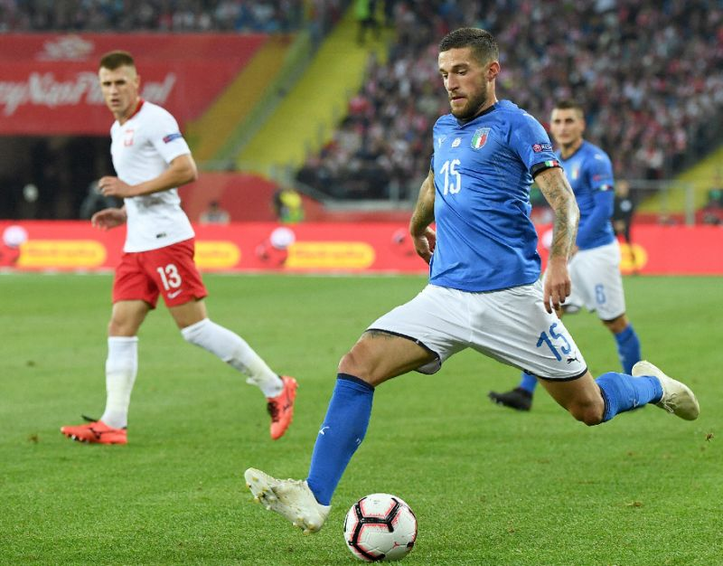 Last-gasp Biraghi saves Italy, hands Mancini first competitive win