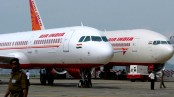 Air hostess falls out of Indian plane