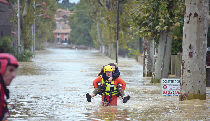 13 die as flooding hits France