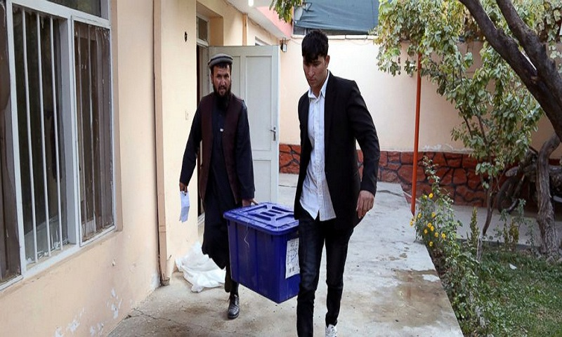 Afghan officials say IED at poll wounds 4