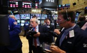 Global stocks mixed amid worries over China, Italy