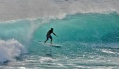 Nudist beach surfer punches shark to escape attack