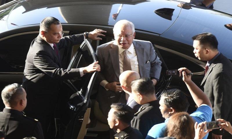 Malaysian ex-PM Najib Razak, former treasury chief charged with graft