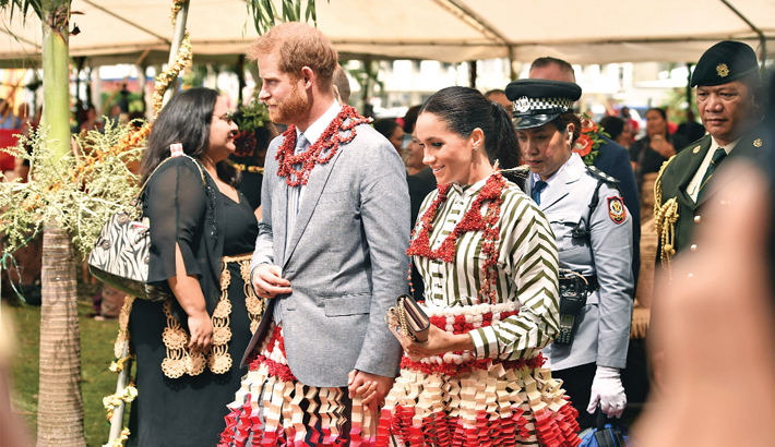 Britain's Prince Harry and his wife Meghan