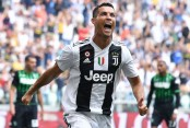 Ronaldo scores 2 as Juventus fights back to beat Empoli 2-1
