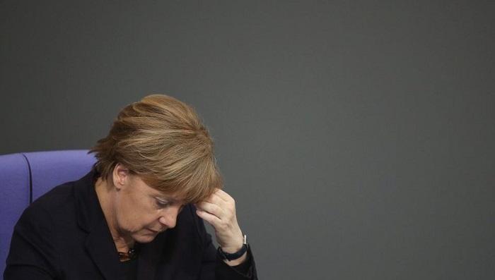 Angela Merkel suffers heavy losses in regional election