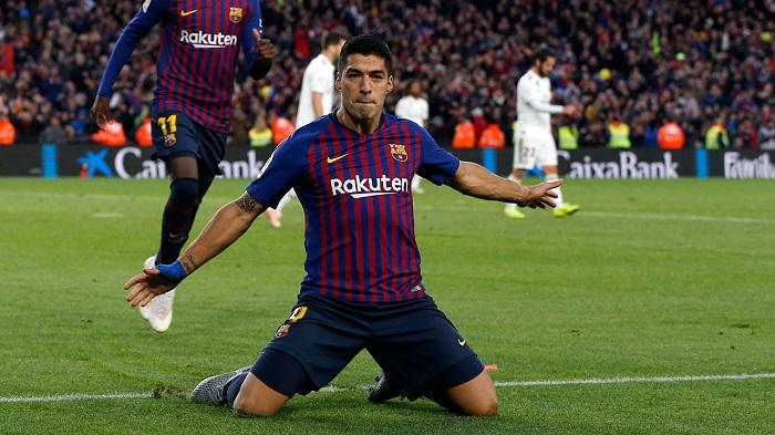 Suarez hat-trick gives Barcelona 5-1 victory in El Clasico