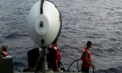 Divers recover jet's data recorder on Indonesia seafloor