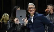 Apple falls below $1tn despite revenue and profit rise