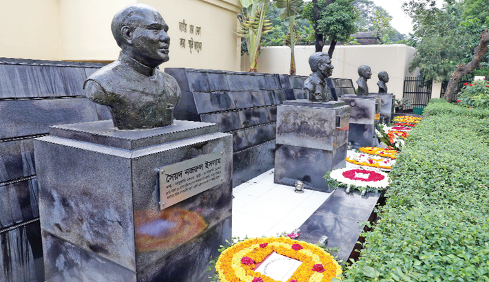 Wreaths are placed in front of the busts of four national leaders