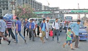 Pedestrians cross busy Airport Road