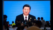 Xi pledges to open China's markets wider to an impatient world