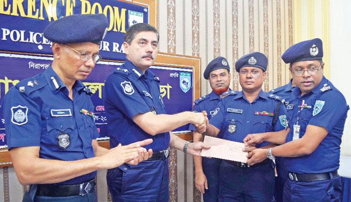 Devdas Bhattacharya hands over best district police award to Nilphamari Superintendent of Police Mohammad Ashraf Hossain