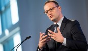 German politician criticized over migration pact