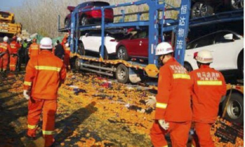 9 dead in 28-truck pile-up in central China