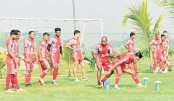 Players of Bashundhara Kings stretch during a practice session