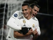 Real Madrid go through top as Gareth Bale leads win over Roma