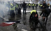 France fuel protests: Tear gas fired in clashes in Paris