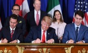 Trump signs trade deal with Mexico and Canada