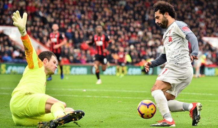 Salah hat-trick sends Liverpool top, Man Utd finally hit form
