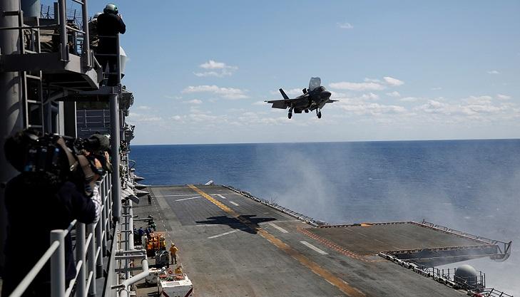 Japan draft defense plan seeks aircraft carrier for US jets